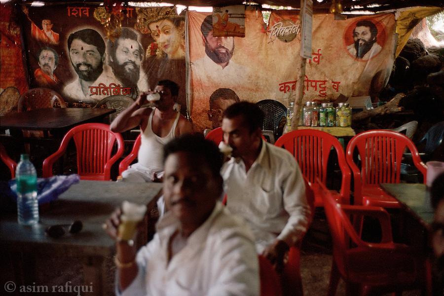 Members of the Shiv Sena take a break at a local tea stall at the Haji Malang shrine whose ownership and spiritual leanings they are challenging