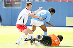 14 December 2008: Maryland's Jason Herrick (left) and UNC's Sheanon Williams (20) try to avoid UNC's Brooks Haggerty as he slides in to claim the ball. The University of Maryland Terrapins defeated the University of North Carolina Tar Heels 1-0 at Pizza Hut Park in Frisco, TX in the championship game of the 2008 NCAA Division I Men's College Cup.