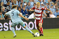 Andrew Jacobson (4) FC Dallas midfielder faces Sporting KC defender Matt Besler... Sporting KC defeated FC Dallas 2-1 at LIVESTRONG Sporting Park, Kansas City, Kansas.