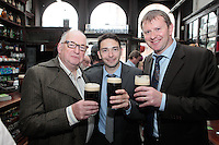 """26/7/2011. Porterhouse Celebrates Fifteen Years of Brewing with another Gold Medal. Pictured at the Sweny Chemist venue in Dublin celebrating are Ernie Whalley, Nigel Tynan and Tony Mc Donagh .The Porterhouse Brewing Company is fifteen years old and to add to the celebrations they have been awarded a gold medal for their Plain Porter. The award, which is much sought after by brewers worldwide, was bestowed upon the Porterhouse's famous Plain Porter at the Brewing Industry International Awards, dubbed, """"The Brewing Oscars"""" in a glitzy ceremony at London's Guild Hall. It is the second time the Porterhouse has received this famous accolade. The first was in 1998 and again it was the Plain Porter that brought home the gold. The awards, with approximately eight hundred and fifty entries, are structured into nine categories with thirty-two classes and medals are extremely difficult to win. Picture Collins Photos"""