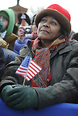 Wilmington, DE - January 17, 2009 -- A supporter listens as United States President-elect Barack Obama delivers remarks at a rally in Wilmington, Delaware, where Obama picked up Biden, on the Whistle Stop Train Tour, on Saturday, January 17, 2009. The ceremonial trip will carry President-elect Obama, Vice President-elect Biden and their families to Washington for their inaugurations with additional events in Philadelphia, Wilmington and Baltimore. Obama will be sworn in as the 44th President of the United States on January 20, 2009. .Credit: Kevin Dietsch - Pool via CNP