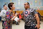 WATERBURY, CT-29 October 2014-102914EC02--    Washington Elementary School Principal Roxanne Augelli gives a gift to Luis Crespo, one of the parents who made a traditional dish Wednesday night for Hispanic Heritage Month. Waterbury families made a total of 18 dishes, filling the auditorium of the school. Erin Covey Republican-American