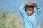 A boy walks to school in Pida, a village in Nepal's Dhading District where the United Methodist Committee on Relief (UMCOR), a member of the ACT Alliance, is helping families to rebuild their lives in the wake of the 2015 earthquake that ravaged much of Nepal.