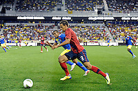 Timmy Chandler (3) of the United States is defended by Cristian Suarez (13) of Ecuador. The men's national team of the United States (USA) was defeated by Ecuador (ECU) 1-0 during an international friendly at Red Bull Arena in Harrison, NJ, on October 11, 2011.