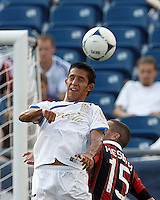 C.D. Olimpia forward Juan Ramon Mejia (17) heads the ball. In an international friendly, AC Milan defeated C.D. Olimpia, 3-1, at Gillette Stadium on August 4, 2012.