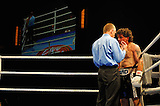 June 19, 2009 - Richmond, BC - Rumble at the Rock IV - Brad McPeake rests while referee Bobby Howard gives him a standing eight count. Heavyweight fighters Jaime Walton of Burnaby, BC, and Brad McPeake of Vancouver squared off in a four round non-title bout. The heavyweight four round event between Walton (3-1) and McPeake (1-11-2) ended at 1:35 of the second round with Walton winning on a TKO.