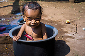 18 month old Prahlad RAMESH reacts while taking a bath in their house in Dhawati VIllage of Khaknar block of Burhanpur district in Madhya Pradesh, India.  Photo: Sanjit Das/Panos for ACF