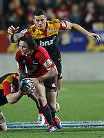 Chiefs' Sonny Bill Williams makes a dive for Crusaders' Zac Guildford in the semi-final Super Rugby match, Waikato Stadium, Hamilton, New Zealand, Friday, July 27, 2012.  Credit:SNPA / David Rowland