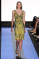 Amanda walks runway in a cadmium yellow graphic embroidered chiffon v-neck cocktail dress, by Monique Lhuillier, from the Monique Lhuillier Spring 2012 collection fashion show, during Mercedes-Benz Fashion Week Spring 2012.