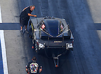 Jun 17, 2016; Bristol, TN, USA; Crew member with NHRA funny car driver Jim Campbell during qualifying for the Thunder Valley Nationals at Bristol Dragway. Mandatory Credit: Mark J. Rebilas-USA TODAY Sports
