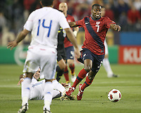Maurice Edu(7) of the USA MNT breaks away from a tackle by Marcos Antonio Caceres(3) of Paraguay during an international friendly match at LP Field, in Nashville, TN. on March 29, 2011.Paraguay won 1-0.