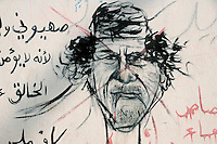 A cartoon drawing of Gaddifi on a wall in Benghazi. On 17 February 2011 Libya saw the beginnings of a revolution against the 41 year regime of Col Muammar Gaddafi.