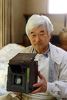 "Yoshikazu Iwase with his father's camera, Iwanoi Brewery, Onjuku, Japan, April 16, 2013.  Onjuku is a small fishing village about 80km south-west of Tokyo. It is famous for surfing beach, ""ama"" free divers and association with the famous children's song ""Tsukinosabaku""."