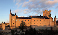 The Alcazar, 12-16th centuries, Segovia, Castile and Leon, Spain. The current Alcazar was begun by King Alfonso VIII (1155-1214) and his wife Eleanor of England (1162-1214), and rebuilt 1258. Juan (John) II (1405-54) added the Gothic style Great Tower. Philip II (1527-98) modified the roofs with slate spires in Northern European style. The Alcazar was subsequently a state prison until it became the Royal Artillery School, 1762. It was damaged by fire, 1862 and restored, 1882, becoming a Military College, 1896. Picture by Manuel Cohen