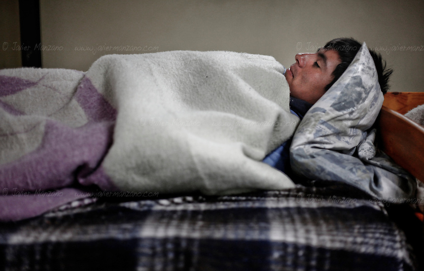 "(at right) Seventeen year-old Valentin Vargas Vargas rests at ""Casa Migrante"", an immigrant shelter in Tecate Mexico on February 7, 2013.  Valentin was deported along with his 4 brothers in Nogales, Arizona on January 27 of 2013. While on detention in Arizona, he was separated from his brothers and deported to Nogales, Mexico. His older brother Francisco was deported along with his three other brothers to Mexicali  and traveled to Nogales to reunite himself with Valentin while the rest of their family went back to Guanajuato. (Javier Manzano / For The Washington Post)."