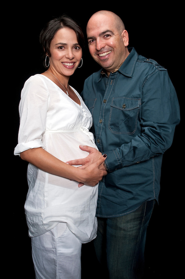 Young expecting couple very happy and smiling proud.