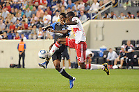 Tony Tchani (23) of the New York Red Bulls plays the ball in front of Khari Stephenson (7) of the San Jose Earthquakes. The New York Red Bulls defeated the San Jose Earthquakes 2-0 during a Major League Soccer (MLS) match at Red Bull Arena in Harrison, NJ, on August 28, 2010.