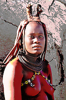 Himba woman, Himba village near Purros, Kaokoland, Kunene Region, Namibia..