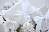 A close-up of ribbon tied Christmas presents and baubles