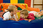 """Albany CA Siblings, four and seven happily interacting at party at local """"Y"""" gym"""