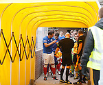 The teams about to emerge from the tunnell at Galabank. Jig adjusts his armband.