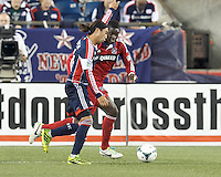 New England Revolution midfielder Lee Nguyen (24) on the attack as Chicago Fire defender Jalil Anibaba (6) defends. In a Major League Soccer (MLS) match, the New England Revolution (blue) defeated Chicago Fire (red), 2-0, at Gillette Stadium on August 17, 2013.