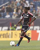 New England Revolution midfielder Shalrie Joseph (21) passes the ball. In a Major League Soccer (MLS) match, the New England Revolution defeated Chicago Fire, 2-0, at Gillette Stadium on June 2, 2012.