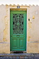 Traditional door with metal design, Ile De Re, France.