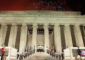 Under fireworks, President-elect of The United States Donald J. Trump and fix family stand for the crowd at the &quot;Make America Great Again Welcome Celebration concert at the Lincoln Memorial in Washington, DC, January 19, 2017. <br /> Credit: Chris Kleponis / Pool via CNP