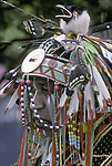 "Native American at pow wow wearing regalia hand made for dance contests at the Thunderbird Eastcoast powwow in Queens NY.... A pow-wow (also powwow or pow wow or pau wau) is a gathering of North America's Native people. The word derives from the Narragansett word powwaw, meaning ""spiritual leader""."