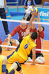 November 18 2011 - Guadalajara, Mexico:  Douglas Learoyd of Team Canada blocks a shot while taking on Columbia in the Bronze Medal Game in the Pan American Volleyball Complex at the 2011 Parapan American Games in Guadalajara, Mexico.  Photos: Matthew Murnaghan/Canadian Paralympic Committee