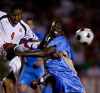 Maryland defender (4) Ethan White clears the ball away from UCLA forward (20) Prince Lapnet at Ludwig Field in College Park Maryland.