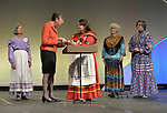 Harriett Olson, top executive of United Methodist Women, presents Melba Checote-Eads of the Muscogee Nation with a cross during opening worship at the United Methodist Women's Assembly at the Kentucky International Convention Center in Louisville, Kentucky, April 25, 2014. Checote-Eads presented Olson with a prayer wheel, and on behalf of local Native Americans welcomed the Assembly members on to Native land.