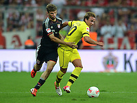 FUSSBALL   1. BUNDESLIGA   SAISON 2012/2013   SUPERCUP FC Bayern Muenchen - Borussia Dortmund            12.08.2012 Thomas Mueller (li, FC Bayern Muenchen) gegen Mario Goetze (Borussia Dortmund)