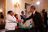 """United States President Barack Obama greets Jayla Mae Dogan, Ashley Cassie Thomas, and  Lucas Cain Beal, all aged 13, of Detroit, Michigan, who are part of a team who focused on designing a city around the theme of """"Fuel Your Future: Imagine New Ways to Meet Our Energy Needs and Maintain a Healthy Planet,""""  while touring student science fair projects on exhibt at the White House in Washington, D.C. on February 7, 2012.  Obama hosted the second White House Science Fair celebrating the student winners of science, technology, engineering and math (STEM) competitions from across the country. .Credit: Molly Riley / Pool via CNP"""