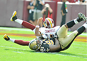 Landover, MD - September 14, 2008 -- Washington Redskins quarterback Jason Campbell (17) is sacked by New Orleans Saints right end Will Smith (91) in fourth quarter action at FedEx Field in Landover, Maryland on Sunday, September 14, 2008. The Redskins won the game 29 - 24..Credit: Ron Sachs / CNP.(RESTRICTION: NO New York or New Jersey Newspapers or newspapers within a 75 mile radius of New York City)