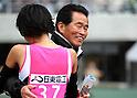(L-R) Risa Shigetomo,  Yutaka Taketomi, JANUARY 29, 2012 - Marathon : Risa Shigetomo of Tenmaya celebrates with her team's head coach Yutaka Taketomi after winning the Osaka International Women's Marathon in Osaka, Japan. (Photo by Toshihiro Kitagawa/AFLO)
