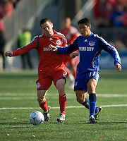 26 April 2009: Toronto FC midfielder Sam Cronin #2 and Kansas City midfielder Roger Espinoza # 17 in action at BMO Field in Toronto in a  game between Kansas City Wizards and Toronto FC..Toronto FC won 1-0.