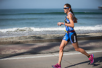 Jenny Fletcher runs down the beach during the run portion of the Accenture Ironman California 70.3 in Oceanside, CA on March 29, 2014.