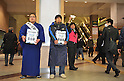 March 22, 2011, Kawasaki City, Kanagawa Prefecture, Japan - A sumo wrestler and Koji Yamase, a professional soccer player from Kawasaki Frontale, a J-League soccer team from Kawasaki, Kanagawa Prefecture, Japan, pitch in at Kawasaki Station to gather donations for survivors of the 2011 Tohoku-Kanto Natural Disaster. The J-League season will be paused for a month and a half due to damage sustained in the earthquakes and tsunamis. (Photo by Atsushi Tomura/AFLO)