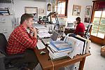 J. Nichols In His Office