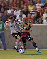 Toronto FC defender Marco Velez (4) and Real Salt Lake forward Yura Movsisyan (14) battle for the ball. Salt Lake Real defeated Toronto FC, 3-0, at Rio Tinto Stadium on June 27, 2009.