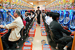 Customers try their luck at a Pachinko parlour in Tokyo on Saturday, June 9, 2007. While there is no direct monetary return in the game, pachinko pinball parlours at least give Japanese gamers the feeling of gambling.