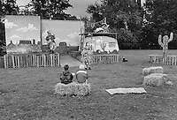 Two children watch the Loony Rooster Theatre in Leintwardine, Herefordshire.