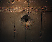 A peephole leading into an isolation cell . Perm province, Russia 2015