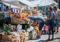 A fruit and vegetable stand in the Chelsea neighborhood of New York on Friday, July 22, 2016.  (© Richard B. Levine)