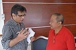 Sudhanshu Singh (left), regional coordinator for the ACT Alliance, talks with Edward Codilla, the mayor of Ormoc, a city in the Philippines province of Leyte that was hit hard by Typhoon Haiyan in November 2013. The storm was known locally as Yolanda. ACT Alliance members have been providing a variety of forms of assistance to survivors here, and Mayor Codilla wrote the Geneva-based network to express his appreciation. Singh accompanied ACT Alliance General Secretary John Nduna during a visit to Ormoc and other typhoon-affected communities to learn first hand about the network's emergency response and long-term plans for recovery and rehabilitation.
