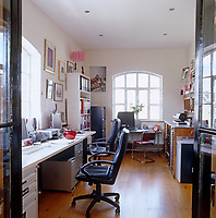 The large home office has desks and computers sufficient for three people