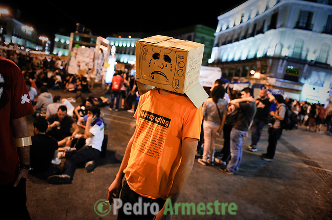 Protestors attend a demonstration against Spain's economic crisis and its sky-high jobless rate at the Puerta del Sol square in Madrid on May 22, 2011. (c) PEDRO ARMESTRE