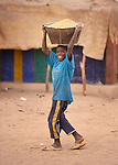 A  boy carries sand on his head for use in construction in Timbuktu, a city in northern Mali which was seized by Islamist fighters in 2012 and then liberated by French and Malian soldiers in early 2013.
